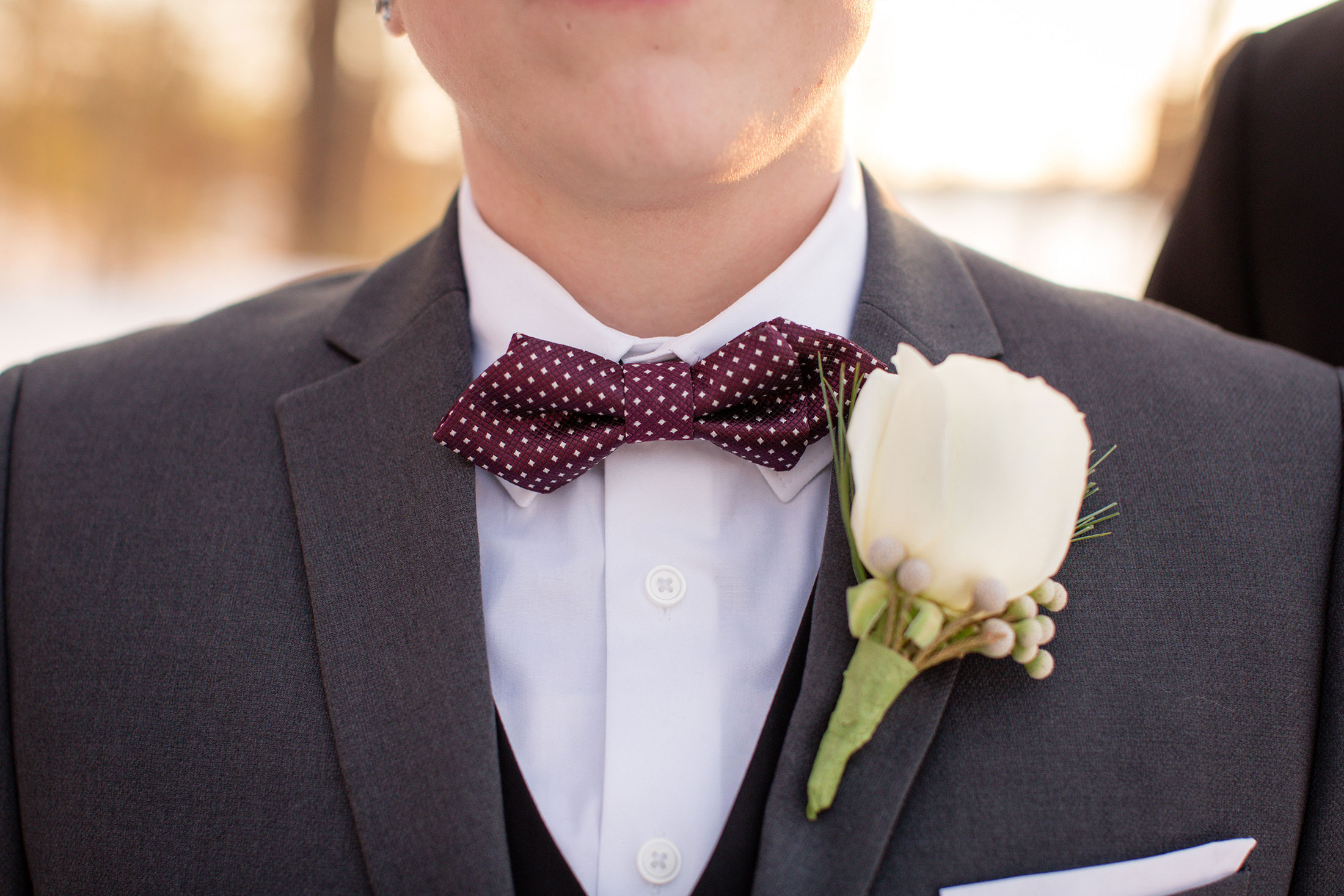 SEG_Bride wearing gray suit and polka dot bow tie