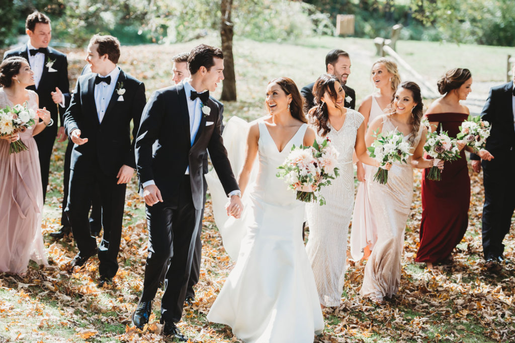 Wedding party walking in woods