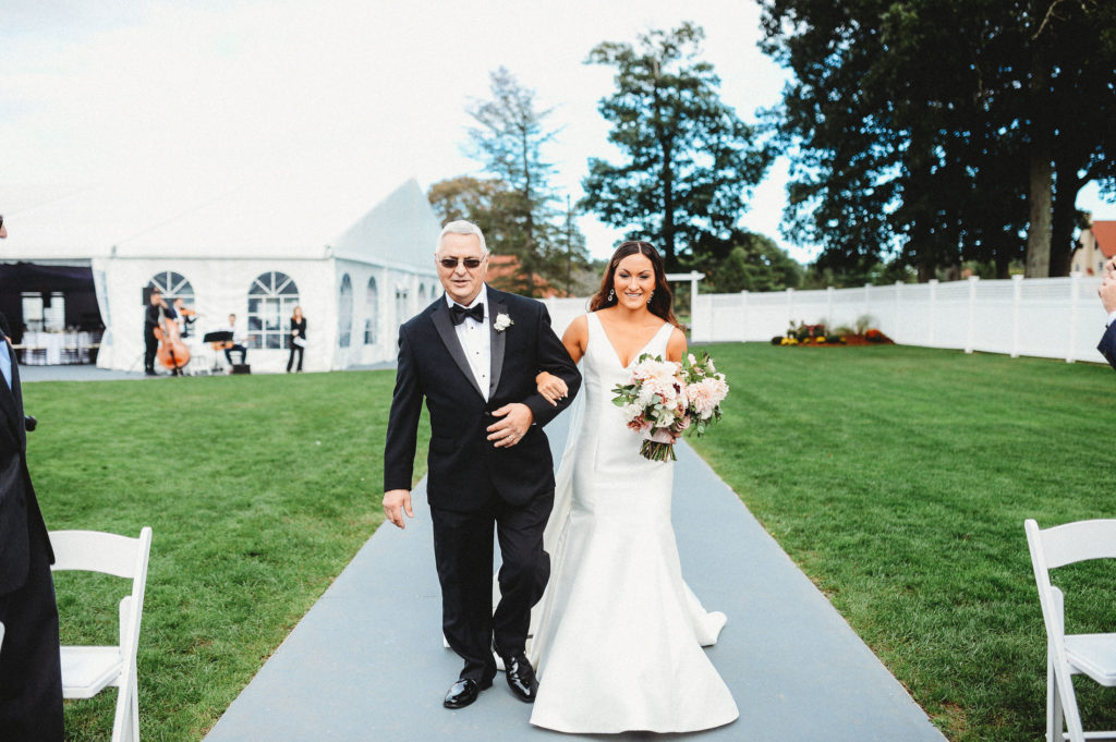 bride and father of bride walking down aisle