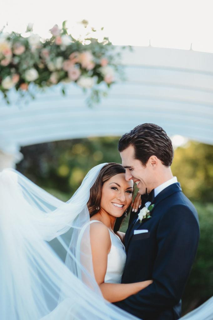 bride and groom at pergola