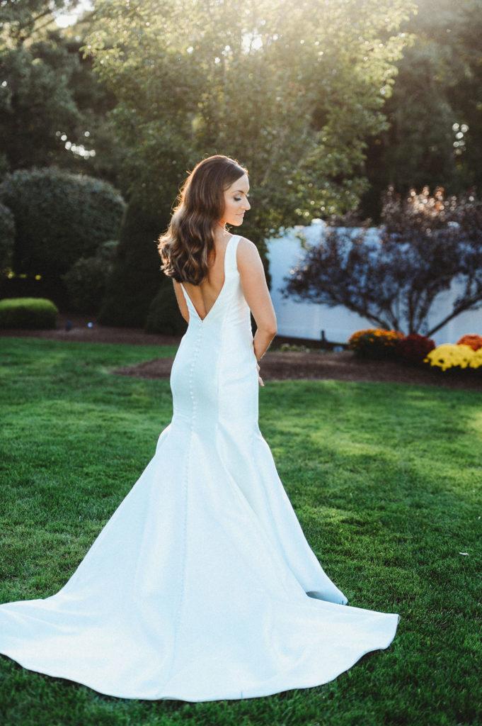 Behind shot of bride in her wedding dress