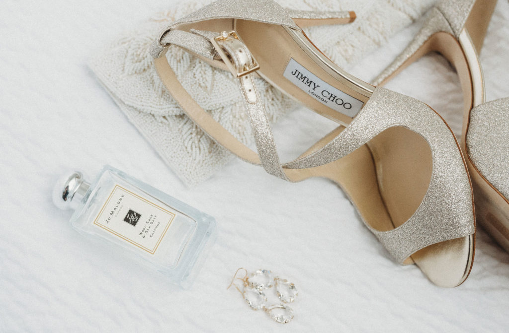 Bride's shoes, perfume, and earrings