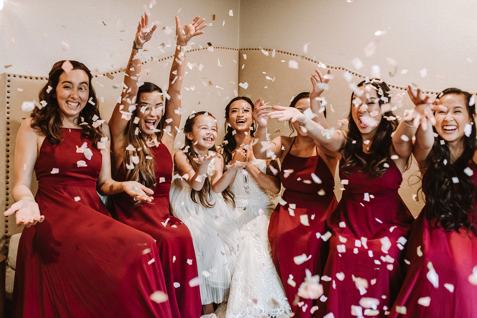 Bridesmaids throwing confetti