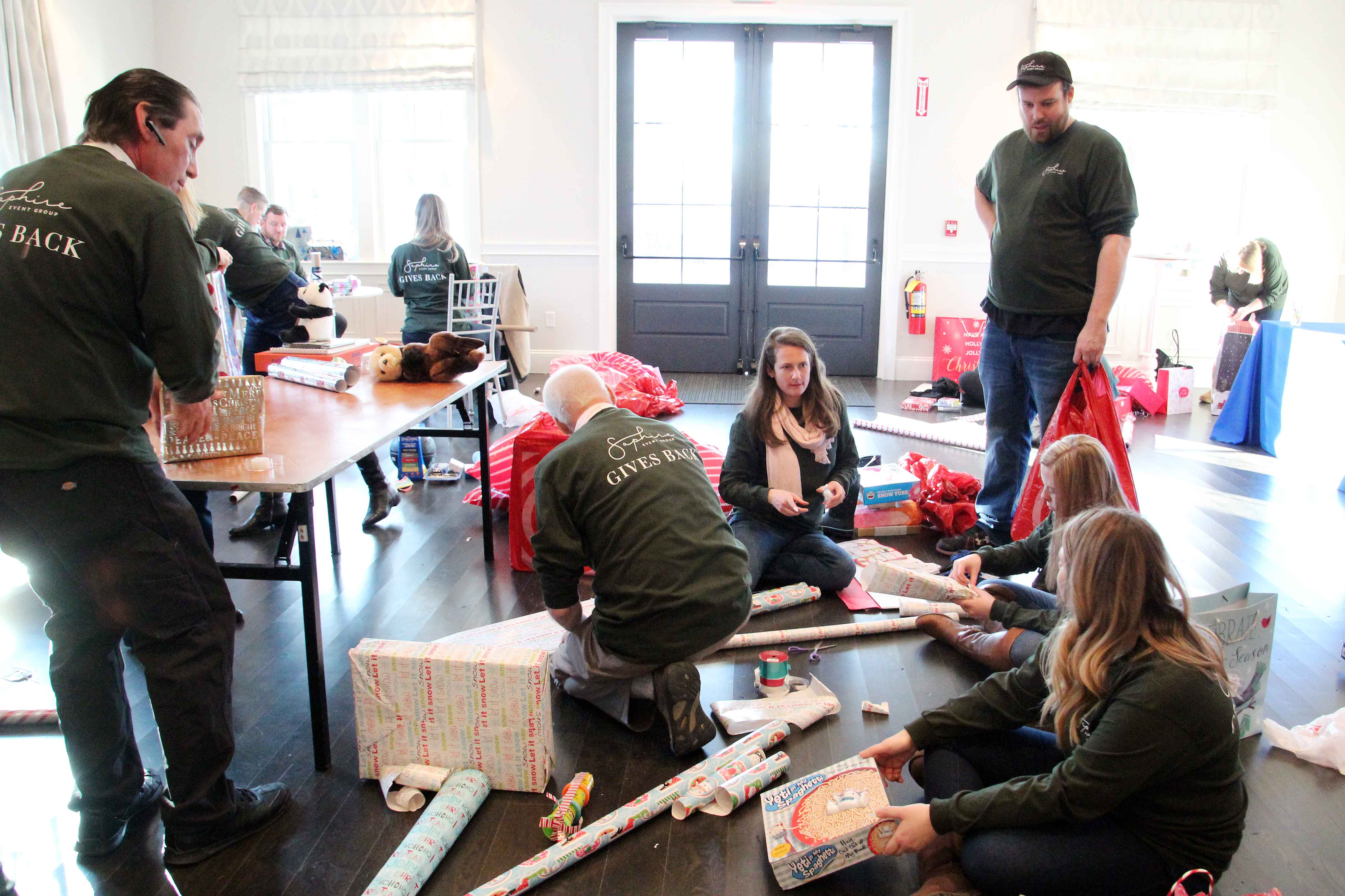 SEG staff wraps holiday gifts for those in need