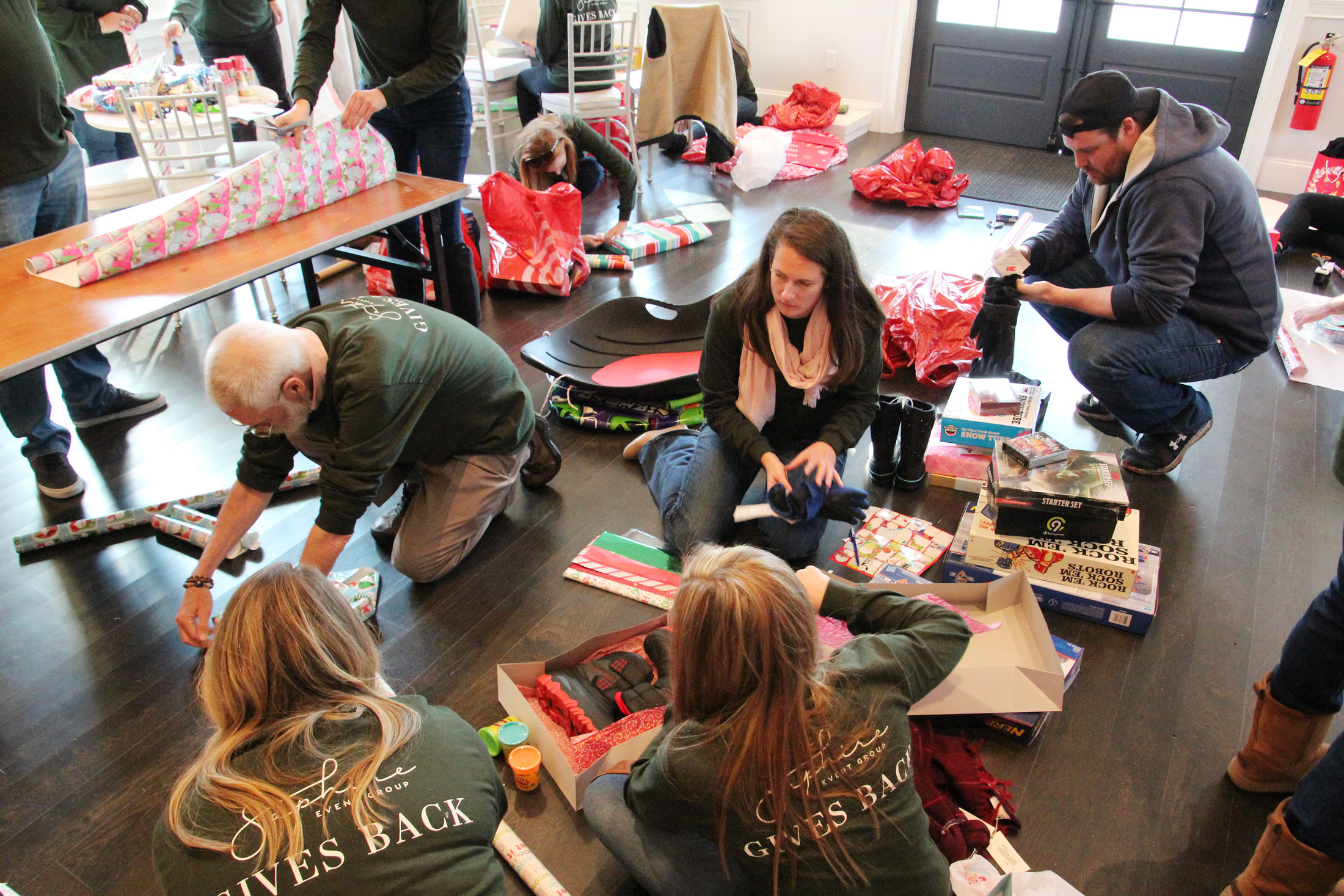 SEG staff wraps gifts for charity program