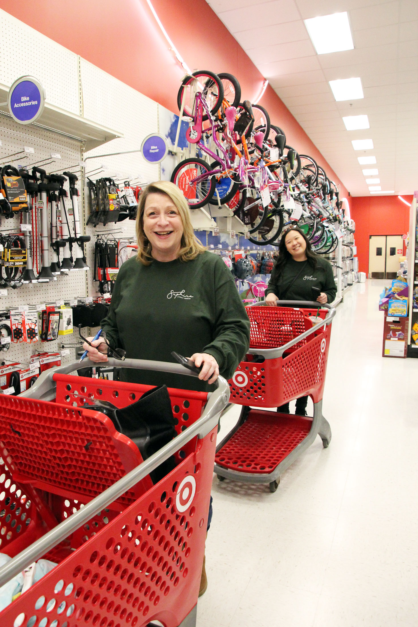 SEG staff pushes carts around Target shopping for holiday gifts