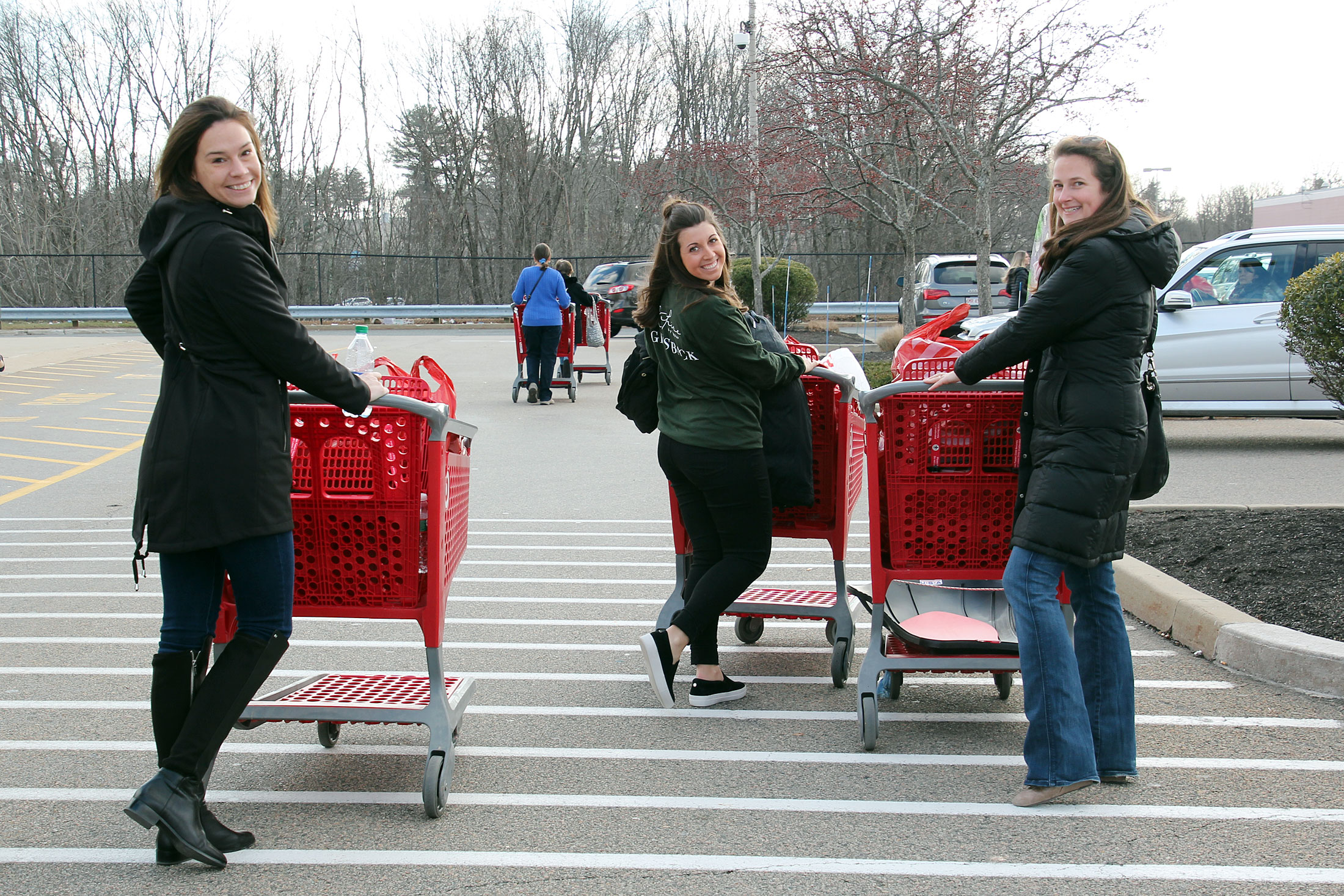 SEG staff in the parking lot at Target after shopping for holiday gifts