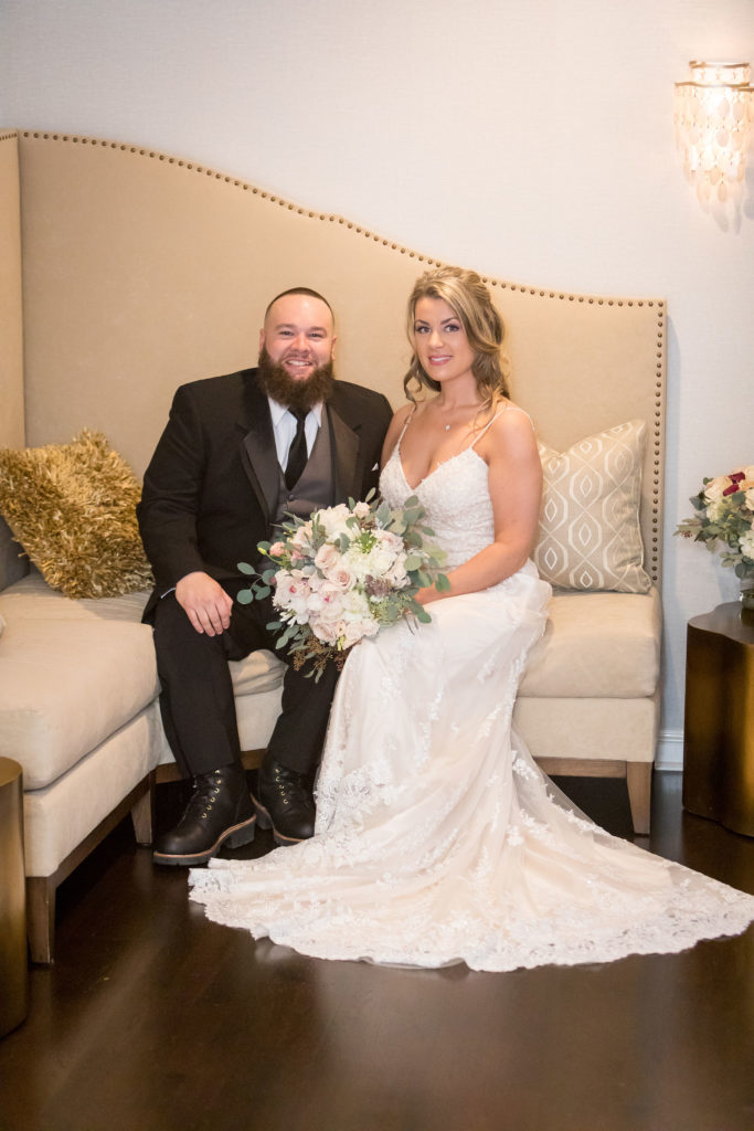 groom and bride in bridal suite