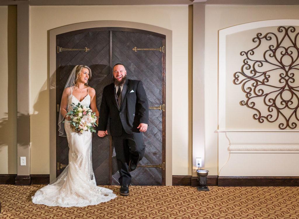 bride and groom portrait in front of door