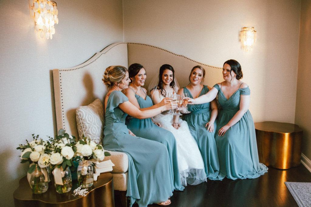 bride and bridesmaid in bridal suite