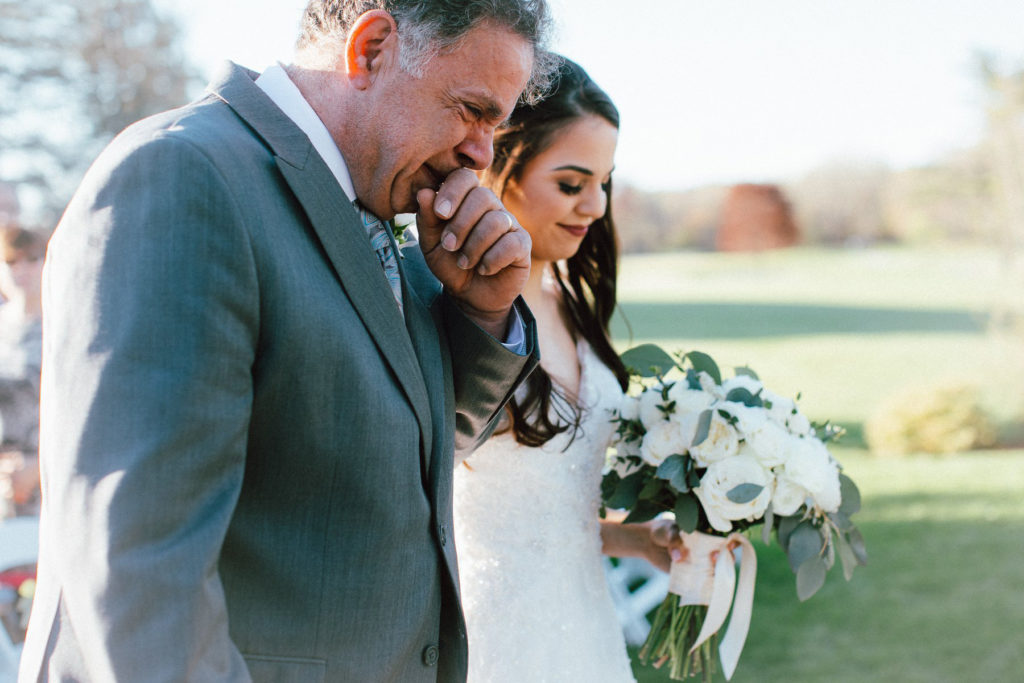 father of bride crying walking bride down aisle