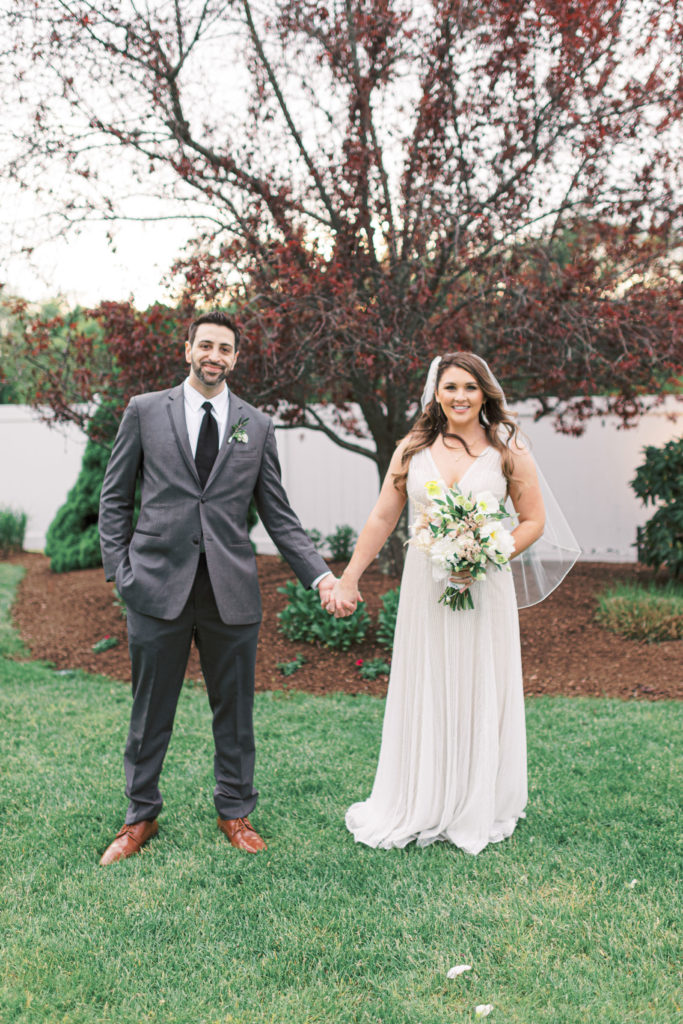 villa-tent-may-wedding-bride-and-groom-holding-hands