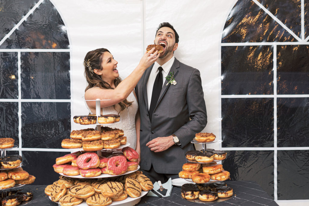 villa-tent-may-wedding-bride-feeding-donut-to-groom