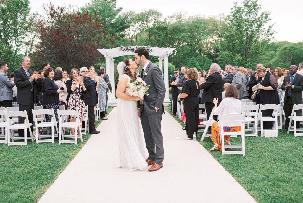 villa-tent-may-wedding-kissing-after-ceremony