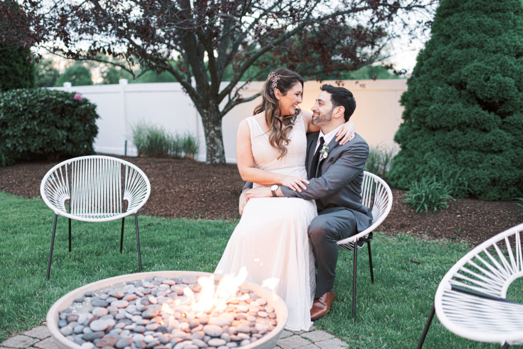 The Villa – The Tent | villa-tent-may-wedding-sitting-by-fire-pit