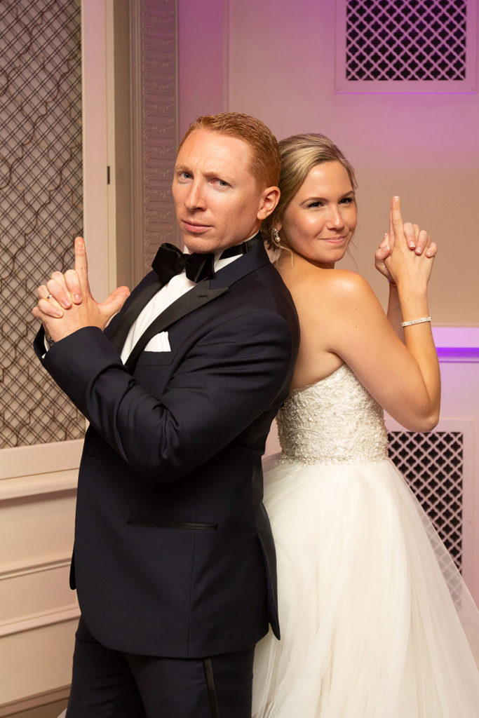 bride and groom doing a funny pose