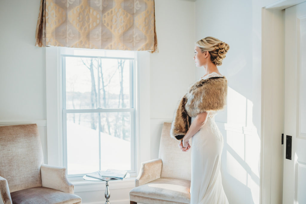 Bride wearing fur at winter wedding