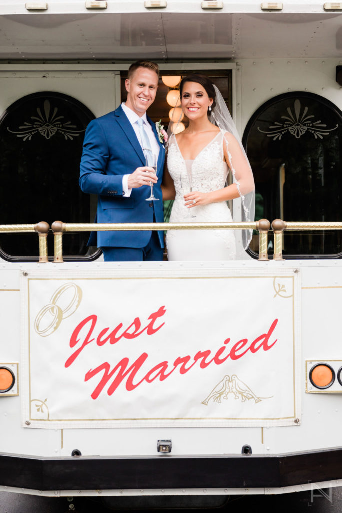 bride and groom on a trolley