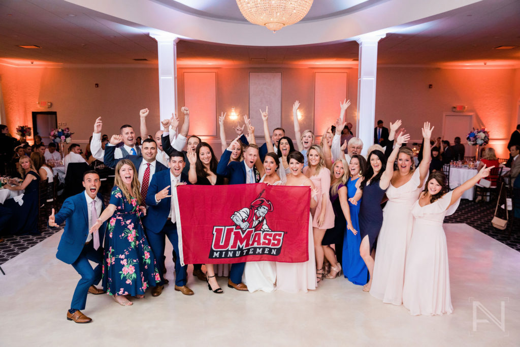 group picture with UMass flag