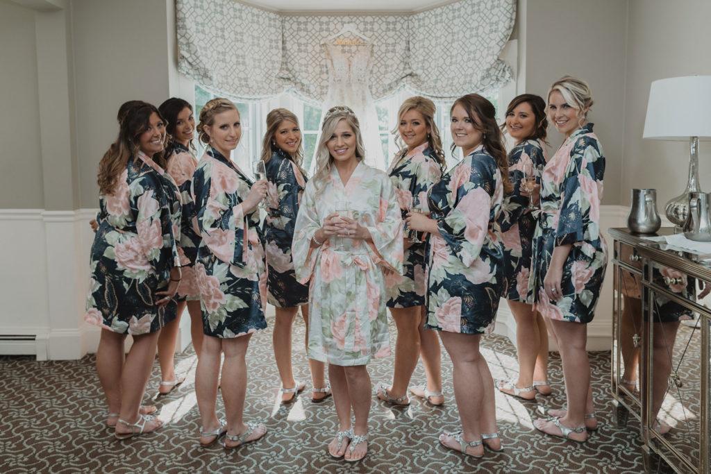 bridal party and bride in bridal suite