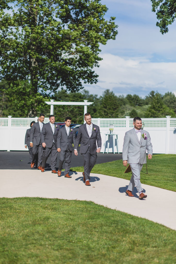Groom and groomsmen walking down aisle