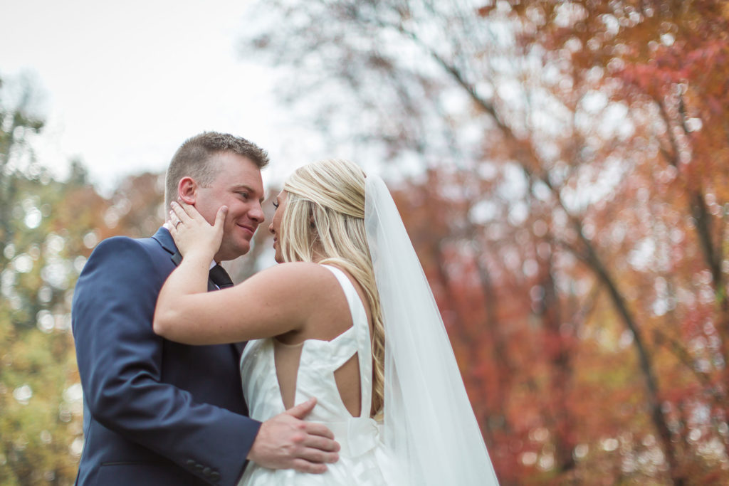 bride hugging groom portrait