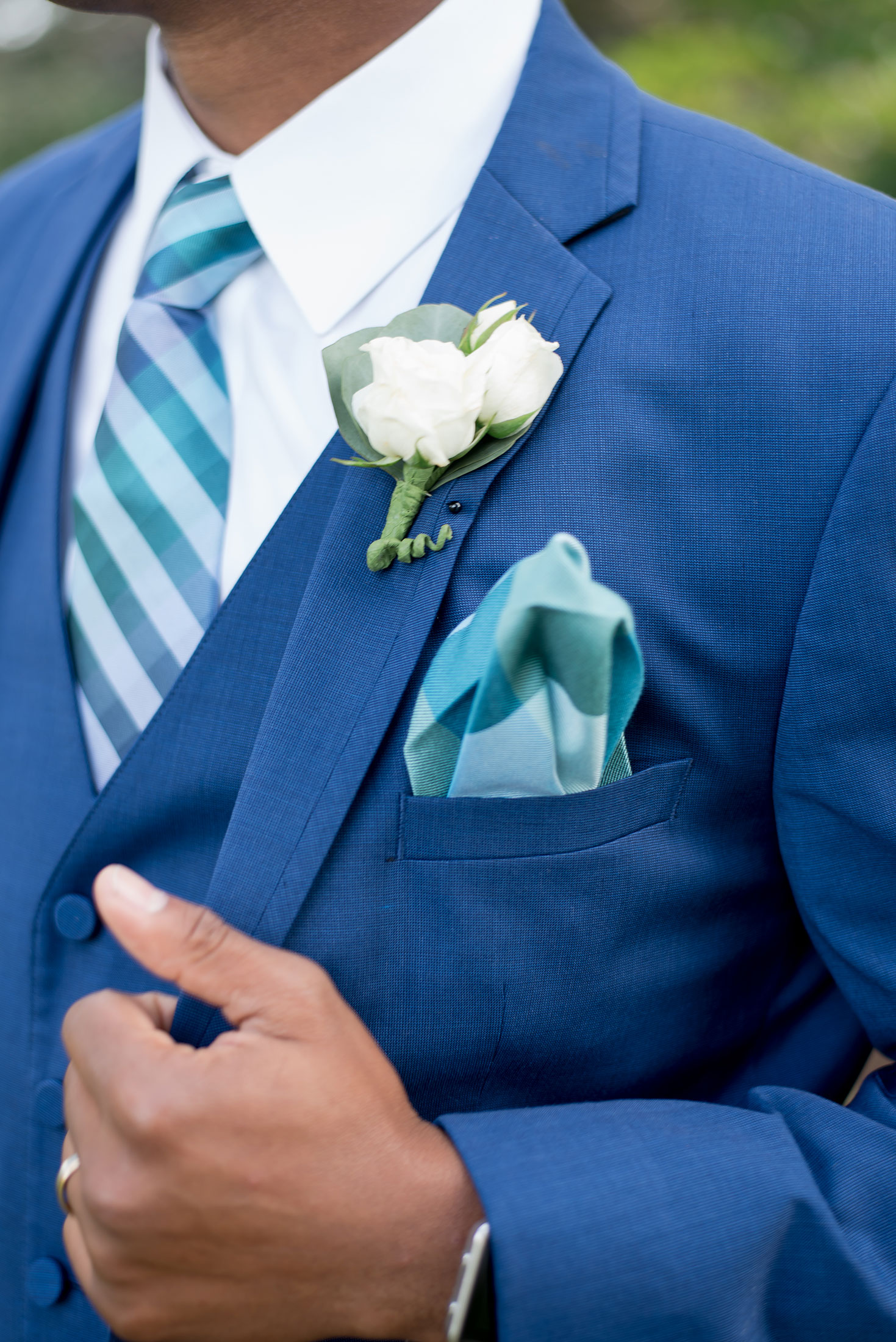Groom in suit that is Pantone wedding color 2020 classic blue