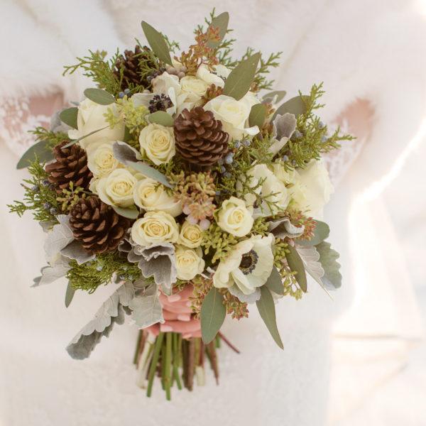 winter wedding bouquet with pinecones