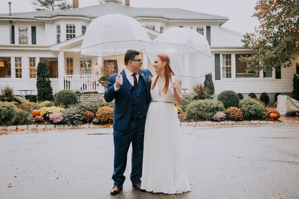bride and groom portrait in front of estate