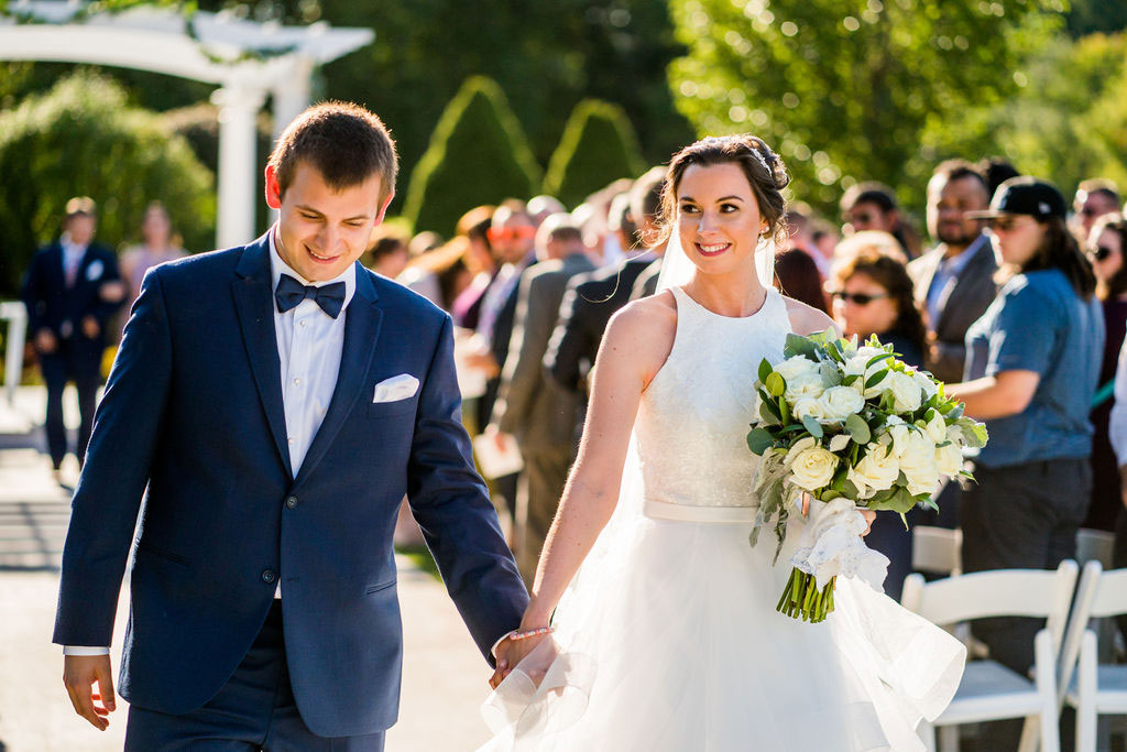 bride and groom walking up the aisle