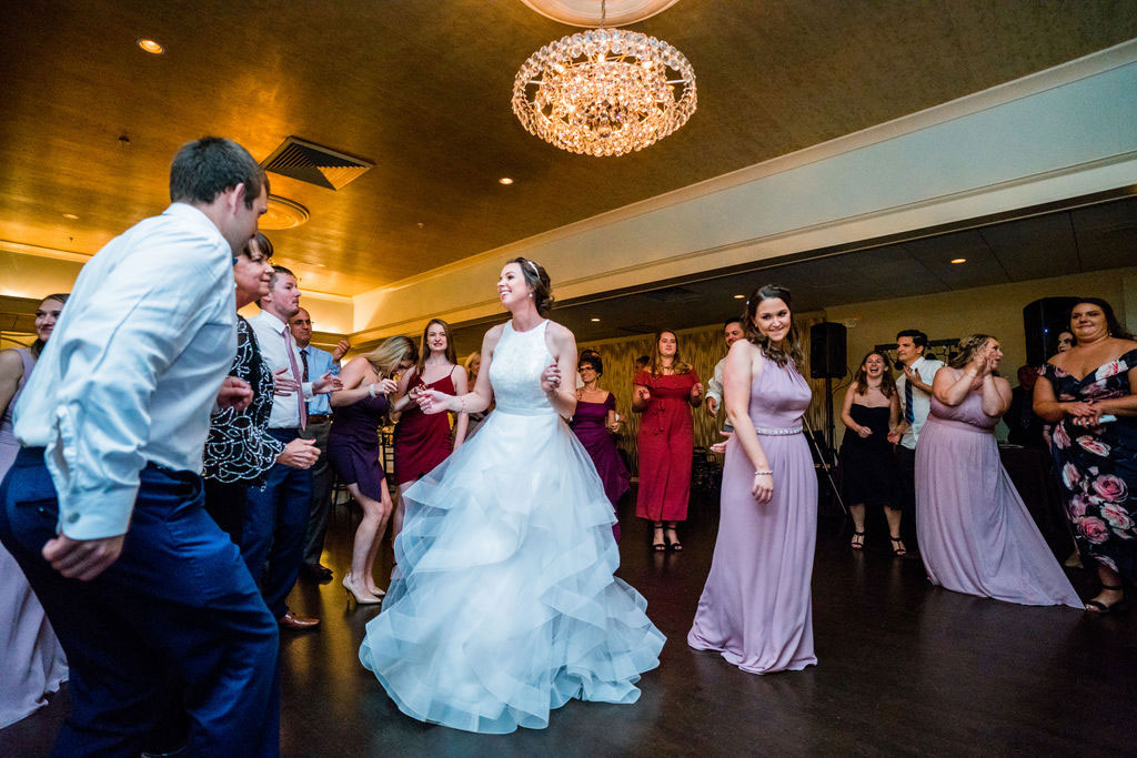 bride dancing with guests