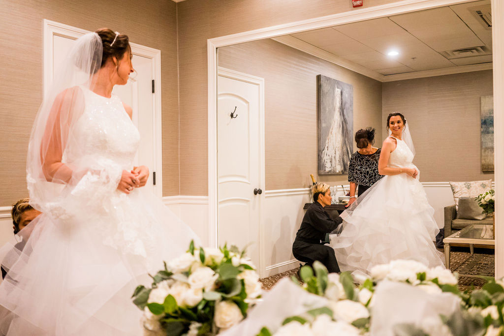 bride getting ready in bridal suite