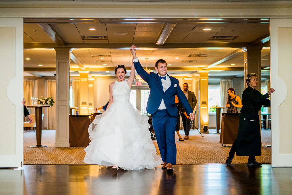 bride and groom walking in for introductions