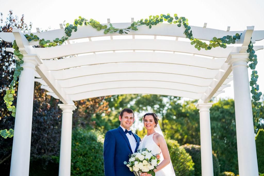 bride and groom portrait at pergola