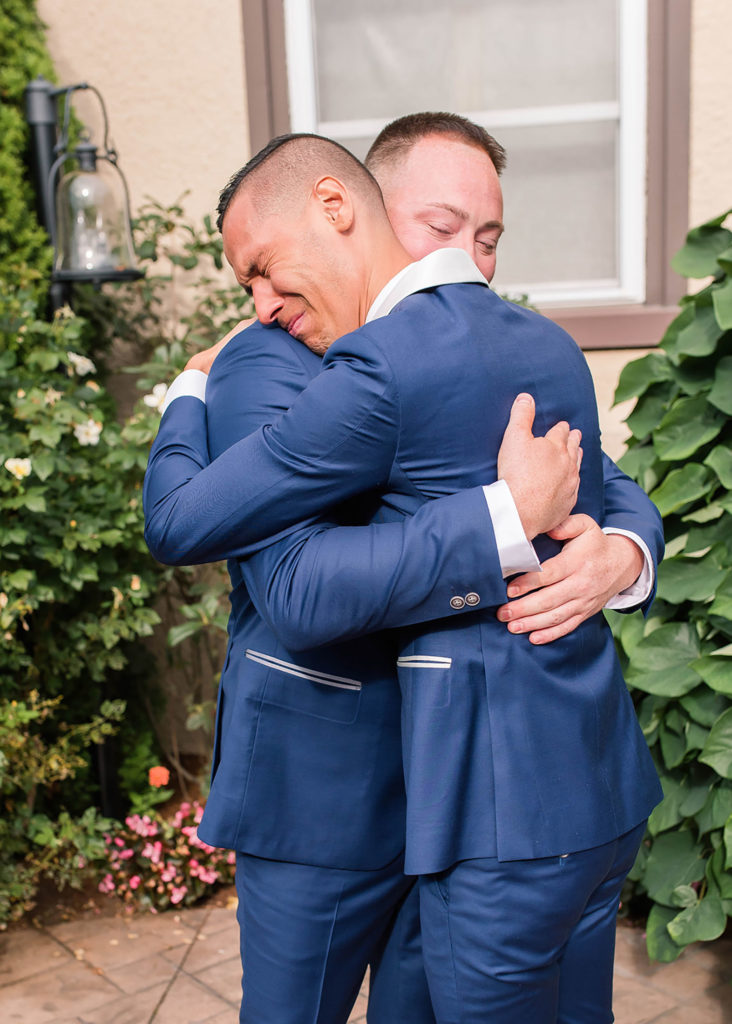 The Villa Madera August wedding Chris and Jason first look hug