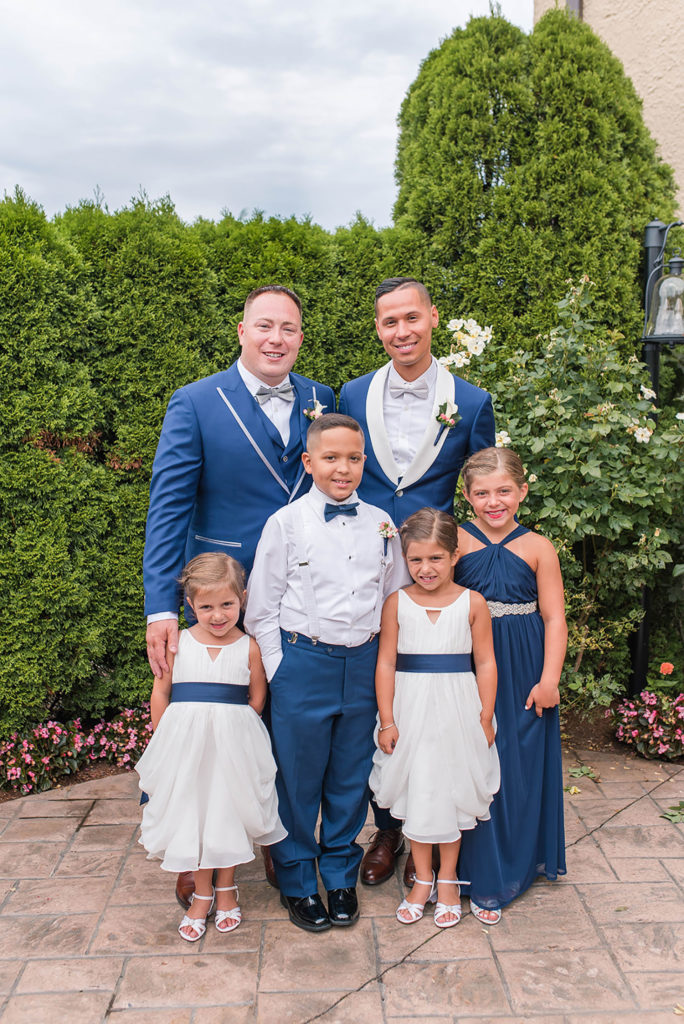 The Villa Madera August wedding Chris and Jason with the children in the wedding party