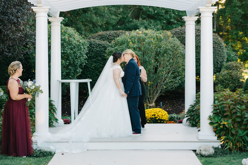 the-villa-grand-ballroom-september-wedding-jocelyn-and-brooke-kiss-at-ceremony