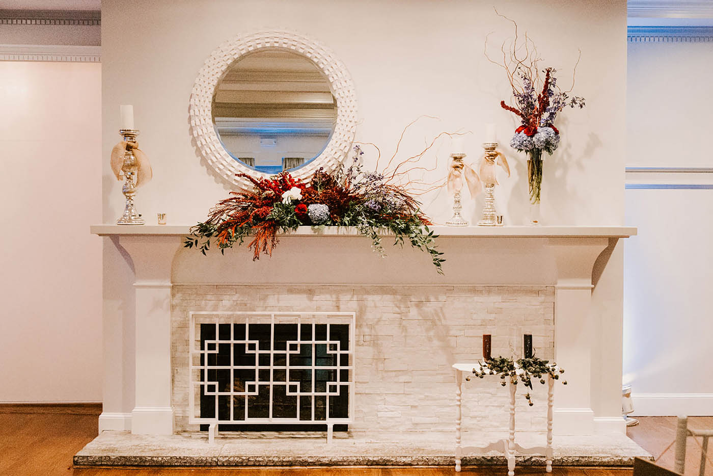 fall wedding decor on fireplace at Saphire Estate