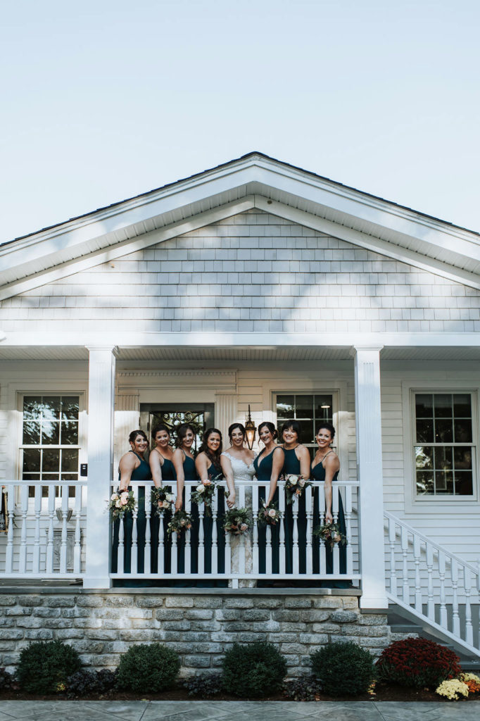 bridal party in front of estate