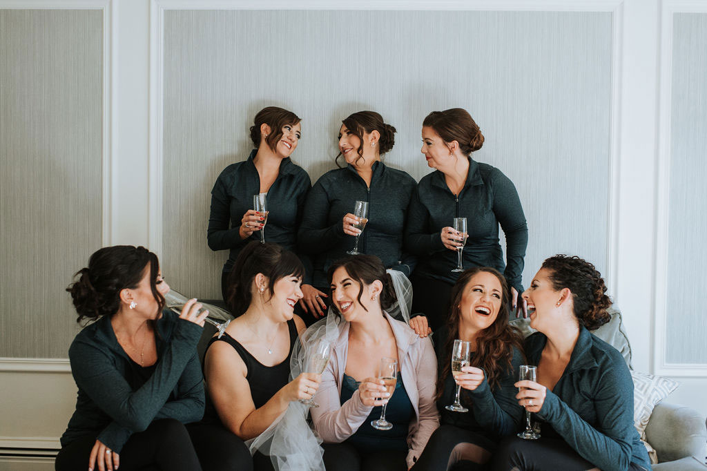 bride and bridesmaids in bridal suite