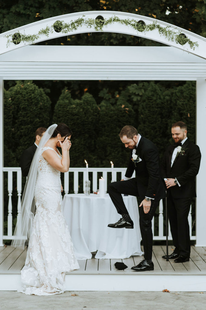groom breaking the glass at ceremony