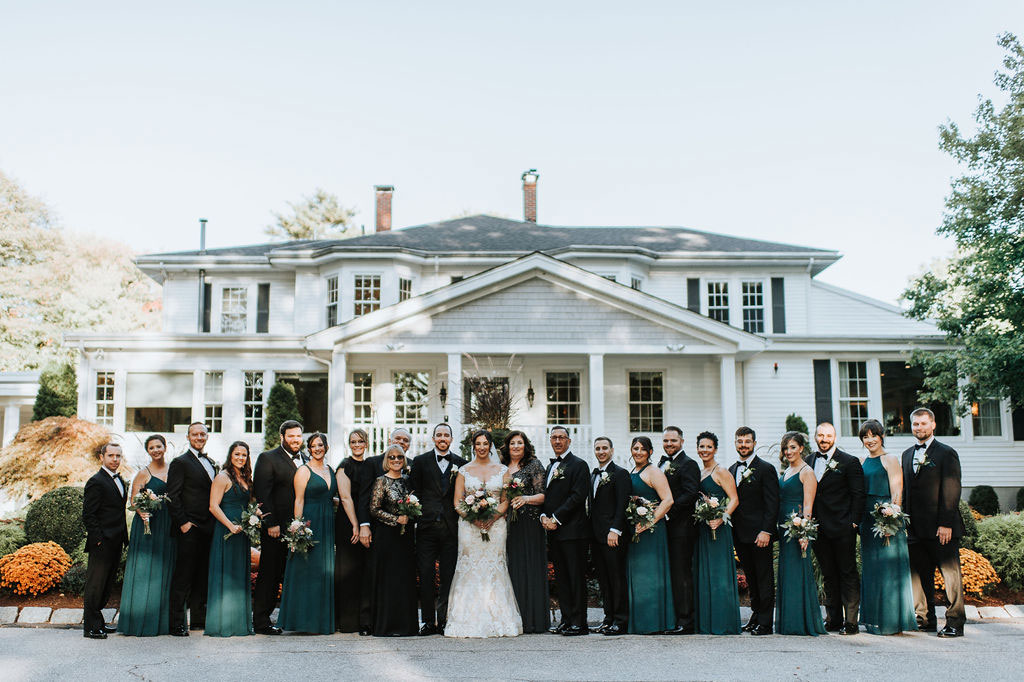wedding party in front of estate