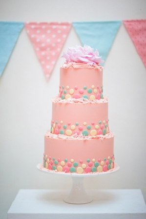 Pink cake with pastel accents