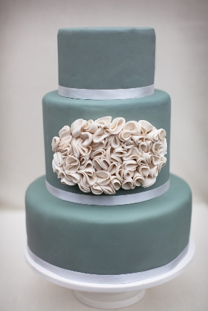 Blue cake with white ruffle design