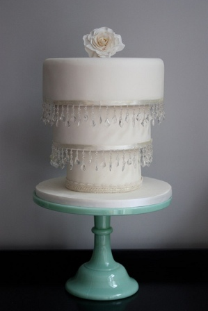 White reverse cake on teal stand